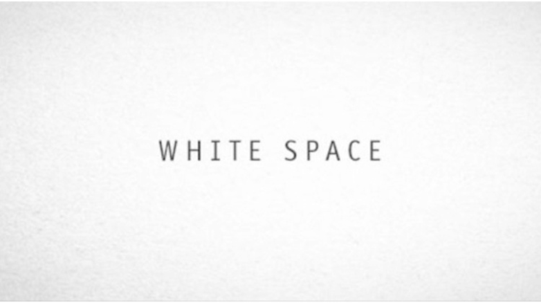 "Picture of white background with black words ""White Space"" in the center"