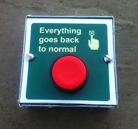 "Picture of red button, next to white text that reads ""Everything goes back to normal"""
