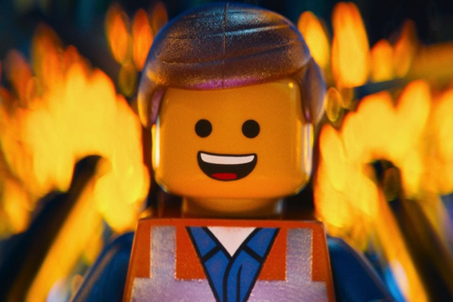 Picture of main character from The Lego Movie, with a building burning behind him